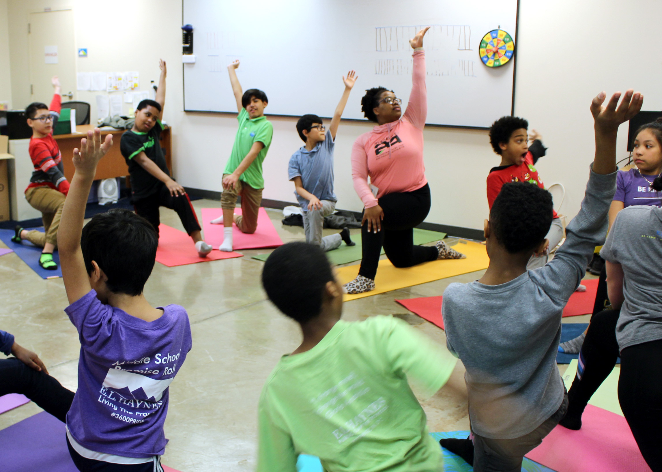 Middle school students learn new yoga poses and practice mindfulness during our annual campus-wide Wellness Day.